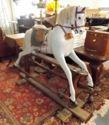 An early 20thC. rocking horse £300