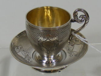 Silver cup & saucer £130