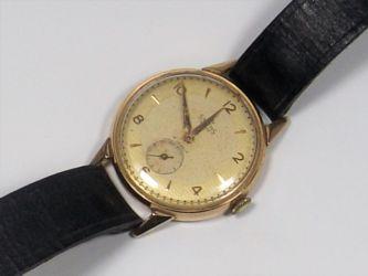 A gold Smiths watch £360