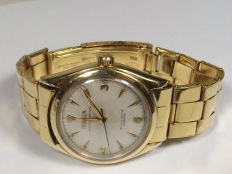 A gold Rolex watch £2500