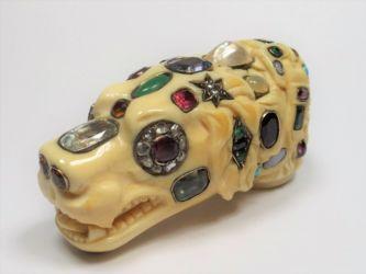 A bewelled ivory cane handle £9800