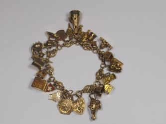 A 9ct gold charm bracelet £500