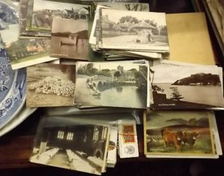 A small quantity of vintage postcards £310